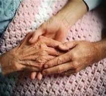 rubbing-an-elderly-hand