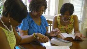 women praying together three