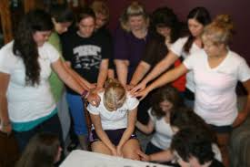 women praying together two