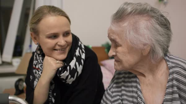 visiting an elderly woman in hospital